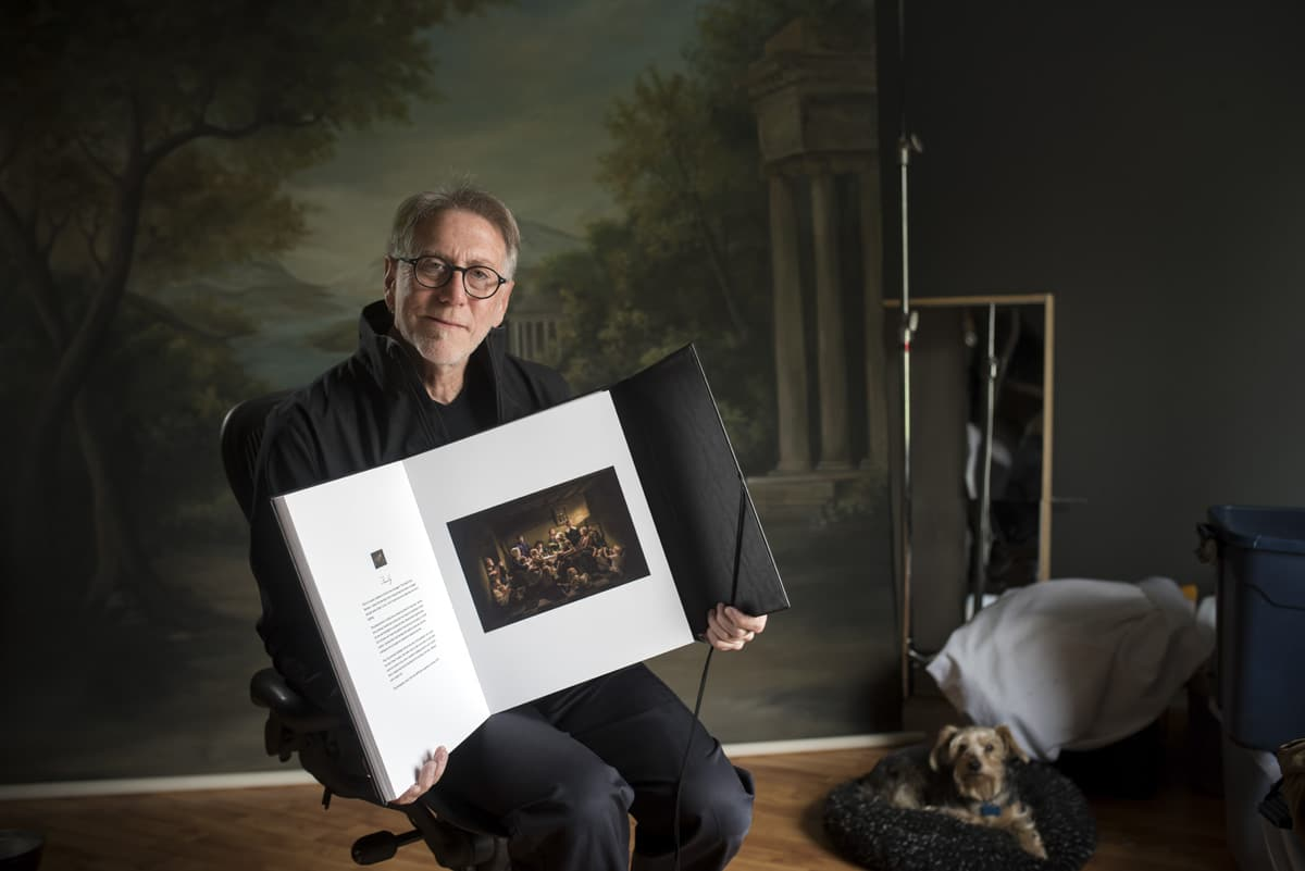 Master Photographer David Edmonson of Dallas, TX enjoying his Queensberry QBook of his fine art photography shown with Distressed Faux Leather in Black.