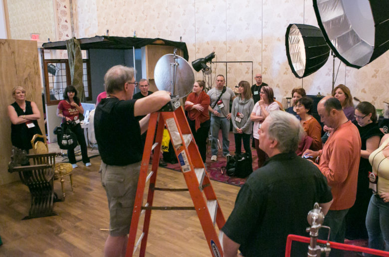 Behind the scenes still shot showing instructing students on set at Texas School for Photography.